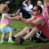 Danvers:<br /> Charlotte Lewis, 2, dances while holding hands with her father, Joel, while listening to the Ray Cavicchio Band at the Rotary Pavillion during the Summer Mardi Gras.<br /> Photo by Ken Yuszkus/Salem News, Tuesday, June 28, 2011.