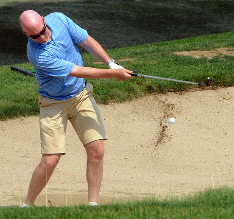 Middleton:<br /> Tom Hamill of Charlestown, hits his ball out of the sand trap near the 18th hole during the Putts and Punches For Parkinson's golf tournament at the Ferncroft Country Club.<br /> Photo by Ken Yuszkus/Salem News, Monday August 9, 2010.