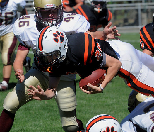 Beverly:<br /> Beverly's Kenny Pierce goes flying through the air while being tackled at the Concord Carlilse at Beverly season opener football game at Hurd Stadium.<br /> Photo by Ken Yuszkus/Salem News, Saturday,  September 11, 2010.