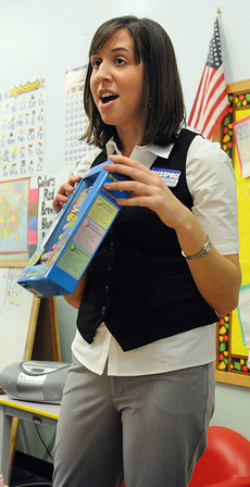 Salem:<br /> Meagan Terry of MASSPIRG, speaks about various dangerous toys. She holds a Bright Lights Phone which emmits a loud noise.<br /> Photo by Ken Yuszkus/Salem News, Tuesday November 24, 2009.