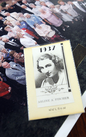Beverly:<br /> A high school graduation photo of Arline ( Fischer is her maiden name ) Nelson rests on a table with photos of past reunions. She graduated in 1937 from Peabody High School and was having a reunion with her former classmates.<br /> Photo by Ken Yuszkus/Salem News, Tuesday, April 17, 2012.