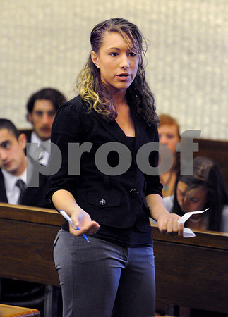 Peabody:<br /> Carrisa Milley, acting as a defense attorney, questions the witness during the mock trial at Peabody District Court. Peabody High School students used the courtroom on thursday morning  to conduct the trial.<br /> Photo by Ken Yuszkus/Salem News, Thursday, April 30, 2009.