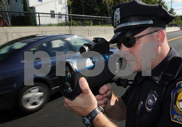 Salem: <br /> Kristian Hanson, Salem patrolman, uses a handheld laser speed gun on the newly opened 107 bypass.<br /> Photo by Ken Yuszkus/Salem News, Tuesday September 10, 2008.