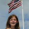 Danvers:<br /> Sarah Cashman, 8, donated $42 to repair the town flag behind her in Danvers square.<br /> Photo by Ken Yuszkus/Salem News, Wednesday, August 3, 2011.