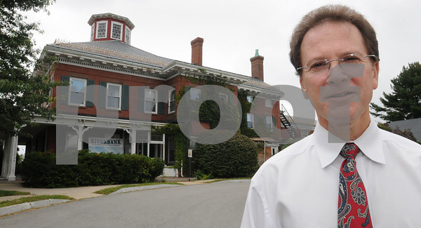 Danvers:<br /> Barry Zeltzer, the executive director of the New England Homes for the Deaf talks about the fiscal constraints the New England Homes for the Deaf<br />  is facing. The old mansion at New England Homes for the Deaf, which was recently sold, is in the background.<br /> Photo by Ken Yuszkus/Salem News, Friday, September 11, 2009.