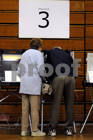 Danvers:<br /> Anne and Ray Gargam cast their vote at the polls during the Danvers Town Election at the high school.<br /> Photo by Ken Yuszkus/Salem News, Tuesday May 5, 2009.
