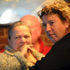 Salem:<br /> Helen Watson-Felt, left, and Gary Young, both of Salem, listen to the musicians perform at In a Pig's Eye on Friday evening during the blues jam. <br /> Photo by Ken Yuszkus/Salem News, Friday,  October 8, 2010.
