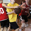 Marblehead:<br /> Tommy O'Hare, center, from the team, Shooting Stars, tries for a shot at the basket as Elizabeth Weisse, left, of The Swish, reaches around at the Jimmy Myers 3-on-3 Basketball Tournament held at the JCC of the North Shore.<br /> Photo by Ken Yuszkus/Salem News, Monday, January 16, 2012.