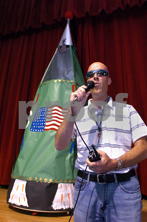 Danvers:<br /> Principal Matt Fusco says a few words just before he is launched in a rocket in front of everyone at the Great Oak School gym. The rocket is behind him on the stage.<br /> Photo by Ken Yuszkus/Salem News, Friday, June 5, 2009.