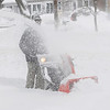 Beverly:<br /> Bill Hansen uses his snowblower to remove the snow on the sidewalk in front of his home during the snowstorm on Monday morning.<br /> Photo by Ken Yuszkus/Salem,  News, Monday,  December 27, 2010.