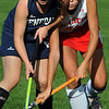 Topsfield:<br /> Hamilton-Wenham's Liviy Ambrose, left, and Masconomet's Becca Phillips clash at the Hamilton-Wenham at Masconomet field hockey game.<br /> Photo by Ken Yuszkus/Salem News, Tuesday, October 11, 2011.