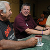 Peabody:<br /> From left,Don Fiorillo, John Channell, and Bruce Rollins talk with friends at Artie's Diner. John has early onset alzheimers. His group of buddies at Artie's Diner -- a place he's been patronizing for several years -- have rallied to support him, buying bracelets, t-shirts and signed up to walk in a fundraiser all to donate to the Alzheimer's foundation.<br /> Photo by Ken Yuszkus/Salem News, Thursday, September 15, 2011.