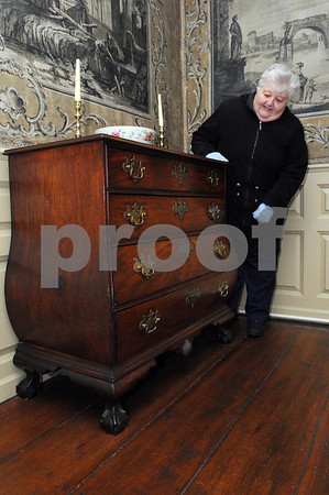 Marblehead:<br /> Joyce King of Wakefield, is examining at a piece of furniture suspected of being made by Nathaniel Gould, a Salem furniture maker from the 18th century. She is inside the Lee Mansion.<br /> Photo by Ken Yuszkus/Salem News, Thursday,  January 15, 2009.