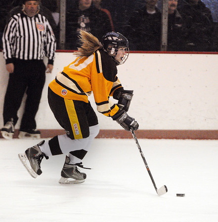 Peabody:<br /> Bishop Fenwick's Emily Galligan heads down ice with the puck during the Bishop Fenwick at Peabody girls hockey game at the McVann O'Keefe Rink.<br /> Photo by Ken Yuszkus/Salem News, Monday, December 26, 2011.