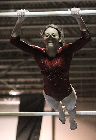 Peabody:<br /> Masco's Rachel DeMarco performs on the parallel bars at the Masco at Peabody gymnastics meet at Peabody Veterans Memorial High School gymnasium.<br /> Photo by Ken Yuszkus/Salem News, Monday, January 9, 2012.