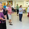 Danvers:<br /> Sue Gamble, left, claps hands during a line dance at the Danvers Council on Aging.<br /> Photo by Ken Yuszkus/Salem News, Wednesday, June 15, 2011.