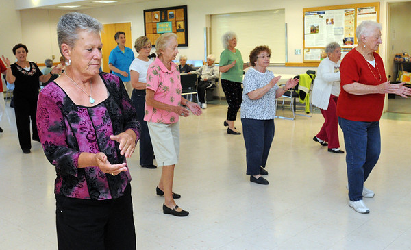 Danvers:<br /> Sue Gamble, left, claps hands during a line dance at the Danvers Council on Aging.<br /> Photo by Ken Yuszkus/Salem News, Wednesday, June 15, 2011.