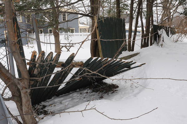 Ipswich:<br /> A broken fence at Whittier Manor is all that prevents a 32 inch fall off the edge into a neighbor's yard. It is one of the various problems on the grounds of the senior public housing that need to be corrected say residents.<br /> Photo by Ken Yuszkus/Salem News, Tuesday, January 5, 2010