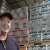 Ipswich:<br /> Daniel Lipke, brewer, stands in the warehouse full of bottled beer and bottled soda at the Mercury Brewing Company. The company has outgrown their manufacturing facilities and are expanding to a new building.<br /> Photo by Ken Yuszkus/Salem News, Thursday, March 19, 2009.