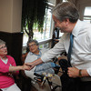 Danvers:<br /> Congressman John Tierney greets residents Rene Woronoff, left, and Marge McManus, center, just before his speech at Colonial Gardens Retiement Community.<br /> Photo by Ken Yuszkus/The Salem News, Thursday, August 16, 2012.