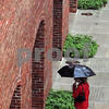 Salem:<br /> A pedestrian walks through the rain under the shelter of an umbrella near the Salem Armory. Heavy rain is forcasted for the area from the storms coming up the coast.<br /> Photo by Ken Yuszkus/Salem News, September 26, 2008.