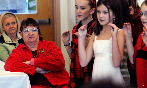 Beverly:<br /> From left, Roseanna Mattson and Jane Silva, listen to the Briscoe Middle School sixth-grade chorus perform at the Council On Aging, Senior Community Center. The Briscoe Middle School sixth-grade band performed also.<br /> Photo by Ken Yuszkus/Salem News, Thurssday, Decmber 10, 2009.