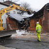 Salem:<br /> Tearing down a building at 38-40 Palmer Street in Salem on Thursday morning.<br /> Photo by Ken Yuszkus/Salem News, Thursday, January 12, 2012.