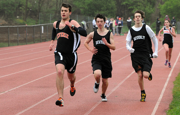 Beverly:<br /> From left, Beverly's Pat McPherson placed first, Michael Scott placed second,and Jeff Kavasch is third in the 2 mile race while heading for the finish line during the Salem at Beverly track meet.<br /> Photo by Ken Yuszkus/Salem News, Tuesday, May 17, 2011.