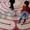 Beverly:<br /> Marjorie Soriano, of Beverly, walks on the canvas labyrinth at the Council On Aging Senior Community Center. Labyrinths are designed to promote relaxation and meditation.<br /> Photo by Ken Yuszkus/Salem News, Thursday,  January 29, 2009.