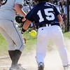 Peabody:<br /> Bishop Fenwick's pitcher, Allissa Begin, rushes home plate and tries to get a handle on a throw from the catcher as St. Mary's Kristina Burri safely comes home at the St. Mary's Lynn at Bishop Fenwick softball game. <br /> Photo by Ken Yuszkus/Salem News, Wednesday, April 7, 2010.