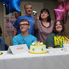 Beverly:<br /> Quadruplets from left, Cullen, Killian, Emma, and Riley Driscoll just blew out the candles on their birthday cakes at their 15th birthday party held at Beverly Hospital and their mother, Mary, asked someone to take a photo with her camera. Next to Mary is the quadruplets' father David. <br /> Photo by Ken Yuszkus/Salem News, Friday, July 13,  2012.