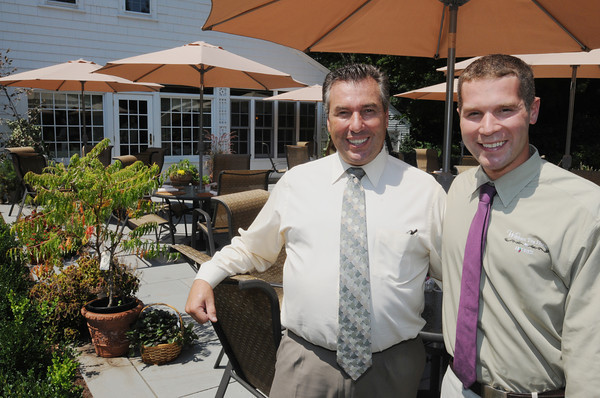 Wenham:<br /> Christopher Keohane, right, Operations Manager of the Wenham Tea House, stands with his father John Keohane at the new patio area of the Wenham Tea House.<br /> Photo by Ken Yuszkus/The Salem News, Thursday, August 9, 2012.