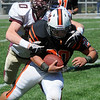 Beverly:<br /> Beverly's Nick Theriault gets tackled by Concord Carlilse's Henry Bumpus at the Concord Carlilse at Beverly season opener football game at Hurd Stadium.<br /> Photo by Ken Yuszkus/Salem News, Saturday,  September 11, 2010.