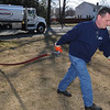 Peabody:<br /> Kevin Dorgan, owner of Direct Fuel, delivers oil to 14 Patricia Road in Peabody.<br /> Photo by Ken Yuszkus/Salem News, Tuesday,  February 28, 2012.