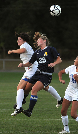 Danvers:<br /> Danvers' Kylie Plaza, left, and Andover's Virginia Duffy hit hard as they go up for the ball during the Andover at Danvers girls soccer game at Deering Stadium. Virginia Duffy got the worst of it.<br /> Photo by Ken Yuszkus/The Salem News, Monday, September 10, 2012.