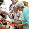 Salem:<br /> Vivian Caron has whipped cream placed on her ice cream sundae while in line. The Salem Council on Aging hosted an ice cream social sponsored by Ben & Jerry's Ice Cream and state Rep. John Keenan at the Senior Center. It was part of Salem's Heritage Days. <br /> Photo by Ken Yuszkus/Salem News, Monday, August 8, 2011.