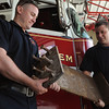 Salem:<br /> Firefighters Tom Brophy, left, and Manny Ataide are holding a piece of steel from the World Trade Center that they will use in a planned monument at the fire headquarters.<br /> Photo by Ken Yuszkus/Salem News, Thursday, June 2, 2011.
