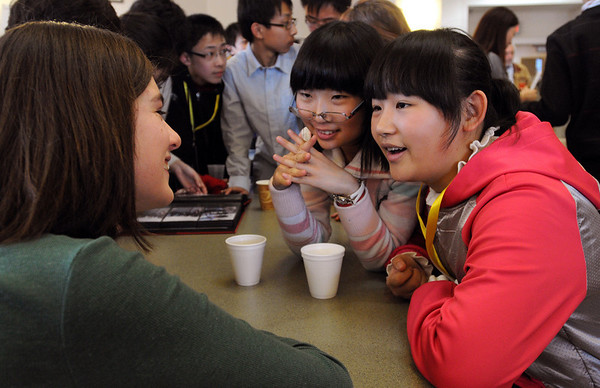 Ipswich:<br /> From left, Zoe Doreu, 8th grader, speaks with visiting Chinese students Wang Xue Xim and Cao Yu Qing over refreshments in the library at the Ipswich Middle School.<br /> Photo by Ken Yuszkus/Salem News, Monday, February 22, 2010.