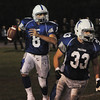 Danvers:<br /> Danvers' Paul Nicolo looks for a receiver as he trails Jake Palazola during the Beverly at Danvers football game at Deering Stadium.<br /> Photo by Ken Yuszkus/Salem News, Friday, October 21, 2011.