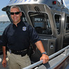 Salem:<br /> Bill McHugh, Salem's harbormaster, has just finished his first year on the job. He is on Salem's newest boat, which is one of four.<br /> Photo by Ken Yuszkus/Salem News, Friday, July 6,  2012.