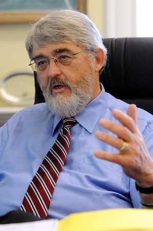 Wenham:<br /> Dr. Raleigh Buchanan, is the new superintendent of Hamilton-Wenham school district. He is in his office speaking during an interview.<br /> Photo by Ken Yuszkus/Salem News, Tuesday August 10, 2010.