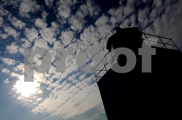 Salem:<br /> The clouds create filtered sunshine near the lighthouse at the end of Derby Wharf.<br /> Photo by Ken Yuszkus/Salem News, Monday,  February 2, 2009.
