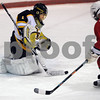 Peabody:<br /> Bishop Fenwick's goalie Craig Forrest scoops the puck as Lynn's #16 Dave Stevens charges the goal during the Lynn vs Bishop Fenwick hockey game at McVann-O'Keefe Rink.<br /> Photo by Ken Yuszkus/Salem News, Friday,  February 20, 2009