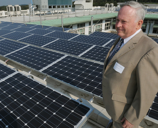 Beverly:<br /> Beverly Mayor Bill Scanlon on the roof of Beverly High School where he spoke during the ceremony to unveil the new solar array on the roof of the school on Wednesday morning.<br /> Photo by Ken Yuszkus/Salem News, Wednesday, September 14, 2011.