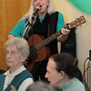 Beverly:<br /> Julie Dougherty sings and plays the guitar and is accompanied by Woody Woodward during the St. Patrick's Day party at the Beverly Senior Center.<br /> Photo by Ken Yuszkus/Salem News, Thursday,  March 15, 2012.