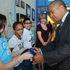 "Salem:<br /> Gov. Deval Patrick accepts a Carlton t-shirt from Carlton student Gwen Robinson when he arrived at the school. Standing near Gwen are students Nyia Capel and Warren Pimentel and adjustment counselor Laurie Mendoza. Gov. Deval Patrick visited Carlton Elementary Thursday afternoon to highlight their new ""innovation school"" model.<br /> Photo by Ken Yuszkus/The Salem News, Thursday, September 13, 2012."