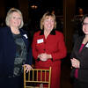 Danvers:<br /> From left, Suzanne O'Brien of Salem, Peggy Pedro of Pelham, NH, and Maria Silva of Peabody, all with North Shore Bank, chat before breakfast at The North Shore Chamber of Commerce event held at the Danversport Yatch Club.<br /> Photo by Ken Yuszkus/Salem News, Wednesday, January 6, 2010.