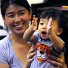 Salem:<br /> Sonia Thai and her son, Spencer, 1, participate in the Play With Me program at the Salem Public Library in the children's room. <br /> Photo by Ken Yuszkus/Salem News, Wednesday, July 13, 2011.