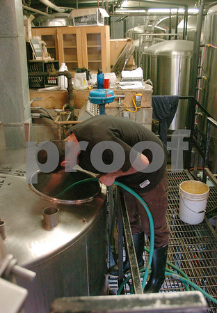 Ipswich:<br /> Mike Ford, brewer, cleans out a kettle at the Mercury Brewing Company.<br /> Photo by Ken Yuszkus/Salem News, Thursday, March 19, 2009.