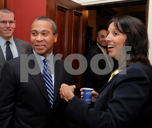 Salem:<br /> Governor Deval Patrick greets people, with Salem Mayor Kim Driscoll at his side, before the start of the meeting in the City Hall. The governor met with the mayor, department heads, members of the city council and school committee to update them on the state budget crisis. <br /> Photo by Ken Yuszkus/Salem News, Wednesday, October 22, 2008.